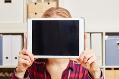 Woman holds a tablet in front of her face Stock Photos