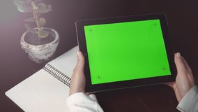 Woman Holds Tablet Pc with Green Screen stock video