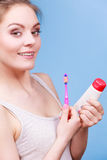 Woman holds toothbrush and paste for teeth cleaning Stock Photography