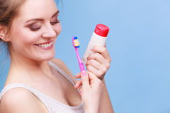Woman holds toothbrush and paste for teeth cleaning Royalty Free Stock Photography