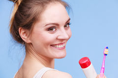 Woman holds toothbrush and paste for teeth cleaning Royalty Free Stock Images