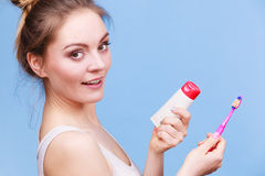Woman holds toothbrush and paste for teeth cleaning Royalty Free Stock Photo