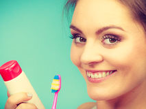 Woman holds toothbrush and paste for teeth cleaning Stock Photo