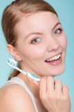 Woman holds toothbrush with toothpaste cleaning teeth Stock Photography