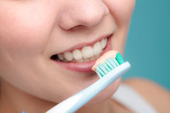 Woman holds toothbrush with toothpaste cleaning teeth Stock Photo