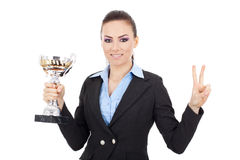 Woman holds a trophy and makes victory sign Stock Images
