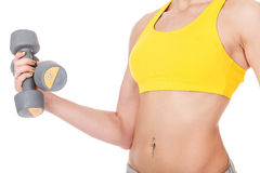 Woman holds two barbells in her hand Stock Photos