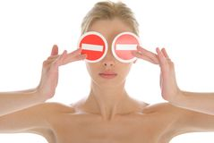 Woman holds two prohibiting signs before eyes Stock Photo