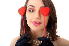 Woman holds two red hearts, isolated on white Stock Photography