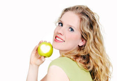 Woman holds up a green apple Stock Image