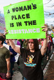 Woman Holds Up Sign Walking In Trump Protest March. Atlanta, GA, USA - January 21, 2017:  A woman carries sign that says `A woman`s place is in the resistance` Royalty Free Stock Image