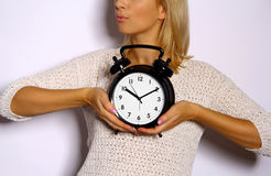 Woman holds watch in hands Stock Image