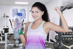 Woman holds water at gym in winter season Stock Photo