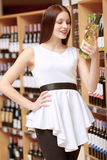 Woman holds a wine bottle Stock Photo