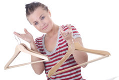 Woman holds wood hangers Stock Images