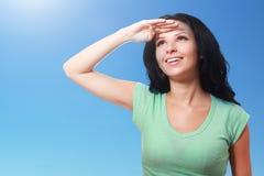 Woman on holiday shading her eyes Stock Image