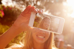 Woman On Holiday Taking Selfie With Mobile Phone Royalty Free Stock Photo