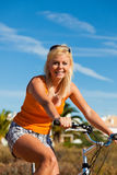 Woman in holidays cycling Royalty Free Stock Image