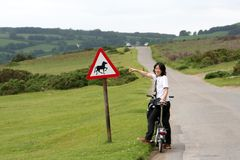 Woman in holidays cycling Royalty Free Stock Photos