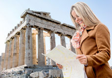 Woman holding a map in Athens Royalty Free Stock Images