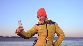 Woman on holidays taking a picture to herself stock video footage
