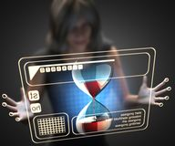 Woman and hologram with hourglass Stock Photo