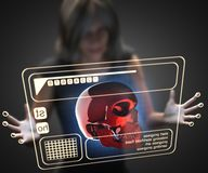 Woman and hologram with skull Stock Image