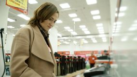 Woman in a home appliance store. stock footage