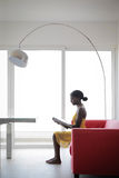 Woman at home. Black woman reading at home Royalty Free Stock Photography