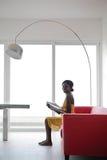 Woman at home. Black woman reding at home Royalty Free Stock Image