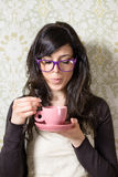 Vintage woman drinking steaming coffee Royalty Free Stock Photography