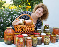 Woman with home canning Royalty Free Stock Images