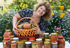 Woman with home canning Royalty Free Stock Photos