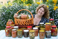 Woman with home canning Stock Images