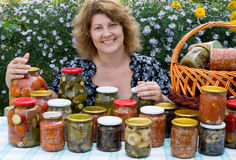Woman with home canning. For the winter royalty free stock photography