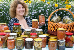 Woman with home canning Royalty Free Stock Photography