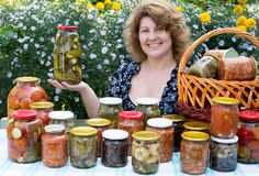 Woman with home canning Royalty Free Stock Photo