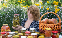 Woman with home canning Royalty Free Stock Image