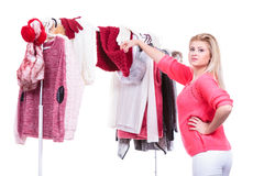 Woman in home closet choosing clothing, indecision Royalty Free Stock Image