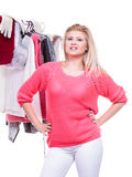 Woman in home closet choosing clothing, indecision Stock Photos