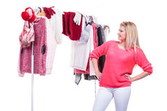 Woman in home closet choosing clothing, indecision Stock Photo