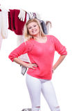 Woman in home closet choosing clothing, indecision Stock Image