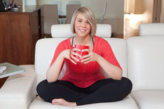 Woman at home with cup of coffee Royalty Free Stock Photography