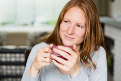 Woman at Home Drinking Coffee Stock Images