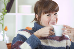 Woman at home drinking tea Stock Images