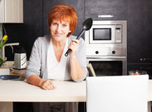 Woman at home Stock Images