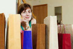 Woman at home with few shopping bags Stock Images