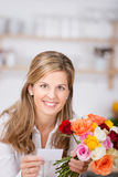 Woman at home With Flowers Royalty Free Stock Photo