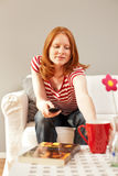A woman at home, getting a drink Royalty Free Stock Photos