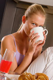 Woman at home having breakfast Royalty Free Stock Photography